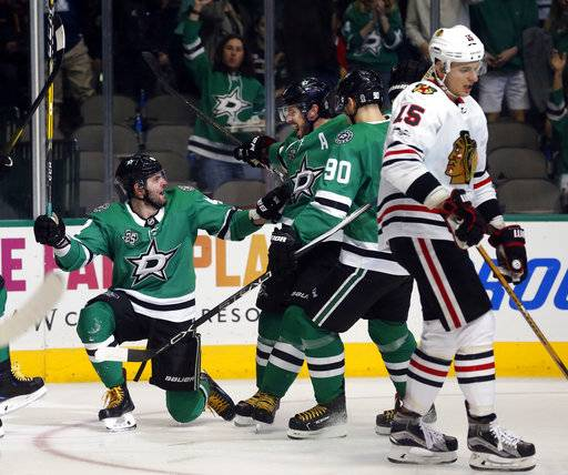 Dallas Stars right wing Alexander Radulov (47) celebrates a goal against the Chicago Blackhawks with center Tyler Seguin (91) and center Jason Spezza (90) as Chicago Blackhawks center Artem Anisimov (15) skates away, during the first period of an NHL hockey game, Saturday, Dec. 2, 2017, in Dallas.