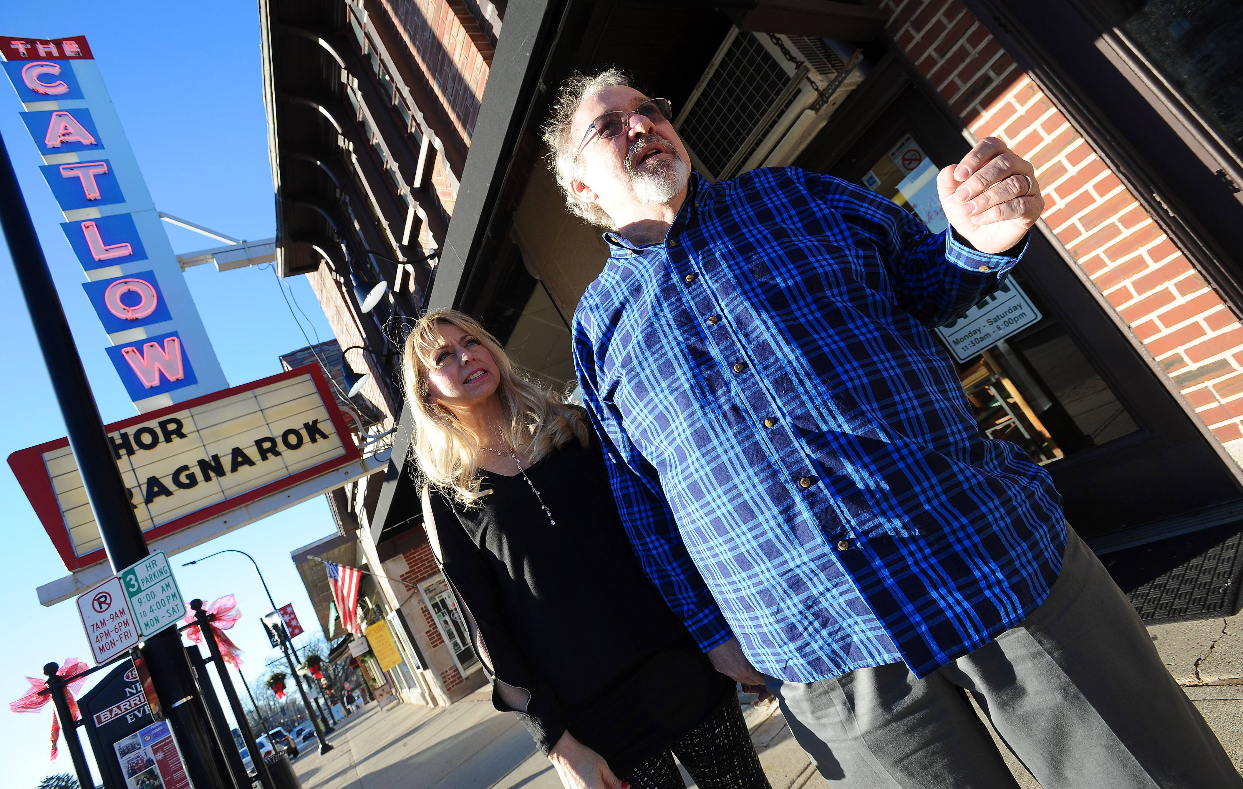 Tim O'Connor, owner of the Catlow Theater and the adjacent Showtime Eatery in downtown Barrington, and his wife, Laura, hope to raise $40,000 through online crowdfunding to help pay for improvements. Here they are outside Showtime, which has a new awning.