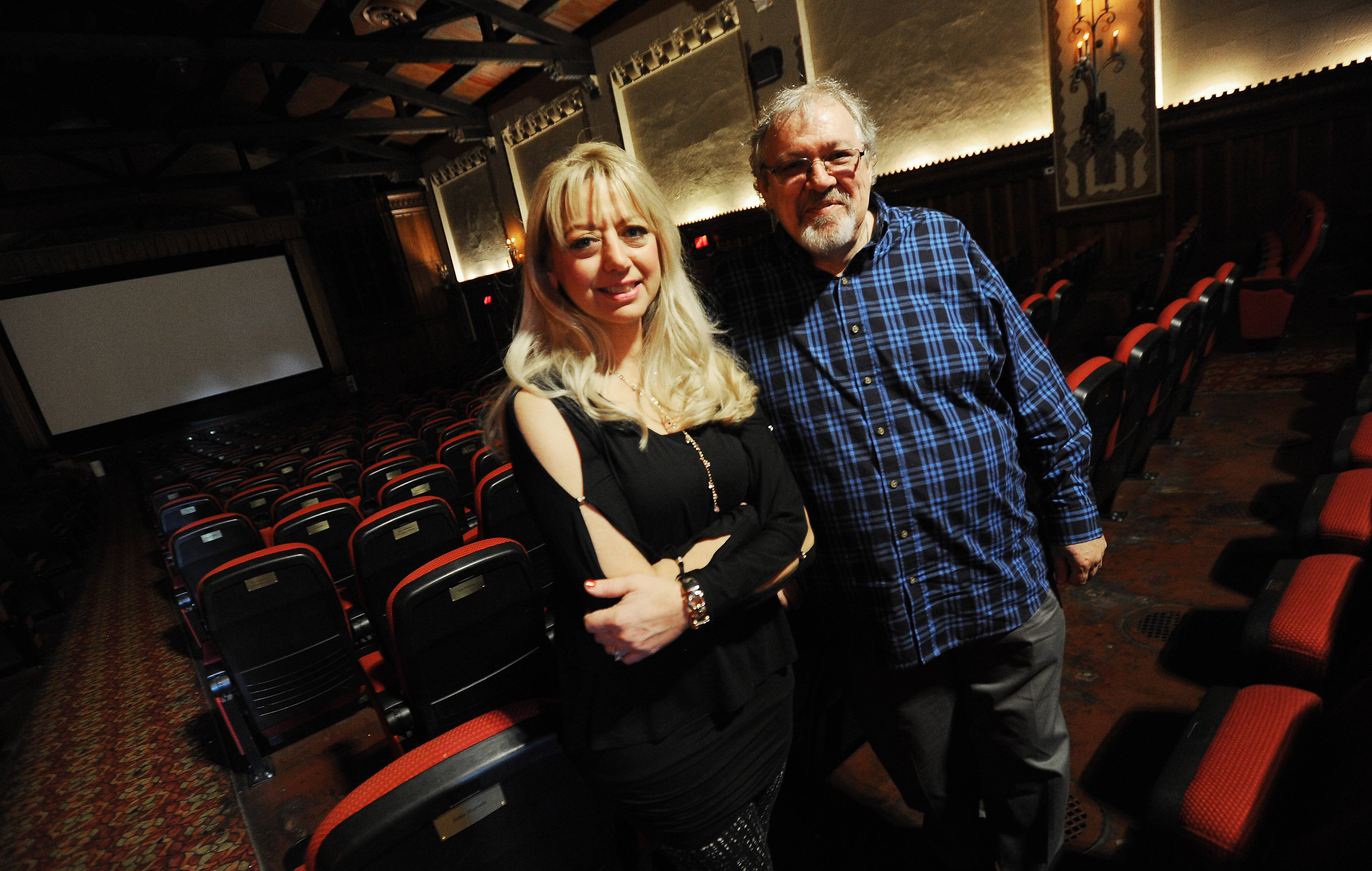 Tim O'Connor and his wife, Laura, inside the Catlow Theater in downtown Barrington.