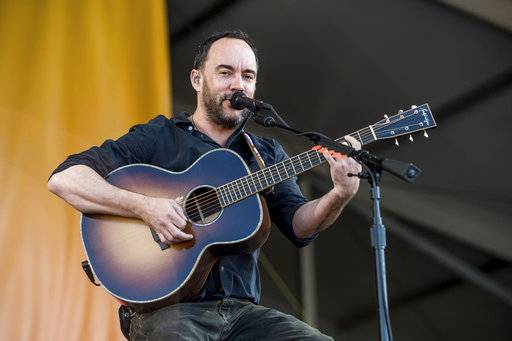 "FILE - In this May 5, 2017, file photo, Dave Matthews performs at the New Orleans Jazz and Heritage Festival in New Orleans. Dave Matthews, Trey Anastasio Band and others will perform a concert at Radio City Music Hall in New York for ""A Concert for Island Relief� on Jan. 6, 2018, to benefit hurricane relief efforts in United States and the British Virgin Islands. (Photo by Amy Harris/Invision/AP, File)"