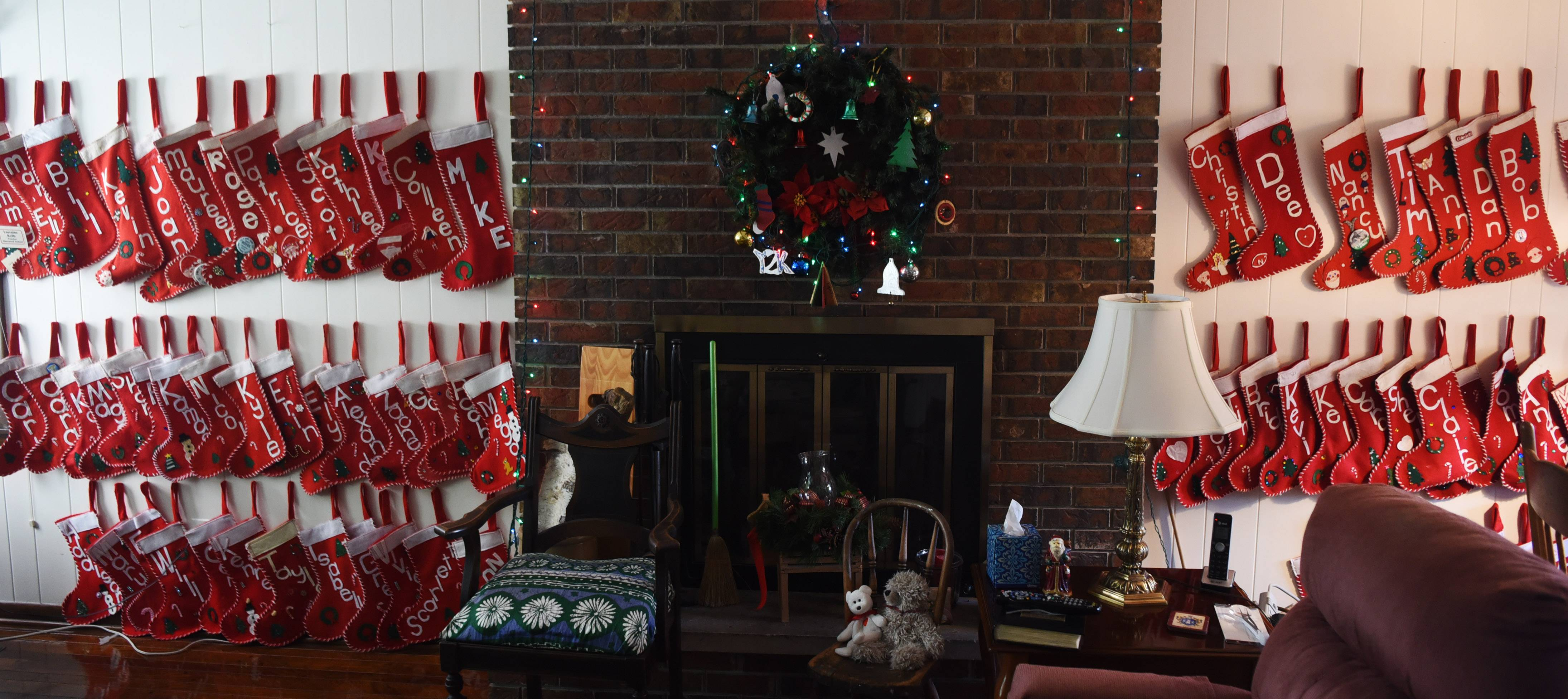 Lorraine Kelly of Arlington Heights has 73 stockings hanging in her house representing each member of her extended family. The colorful stockings fill the wall and are the backdrop for a family celebration that takes place every year on Dec. 23.