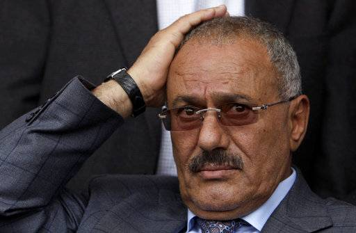FILE - In this April 8, 2011 file photo, then Yemeni President Ali Abdullah Saleh attends a rally with his supporters, in Sanaa, Yemen. Saleh, Yemen's former president and longtime strongman, was killed Monday, Dec. 4, 2017, according to multiple Yemeni officials, as his loyalists and Shiite rebels battled for control of the capital.