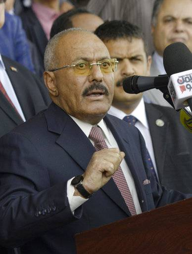 "FILE - In this Aug. 24, 2017 file photo, former Yemeni President Ali Abdullah Saleh speaks during a ceremony to celebrate the 35th anniversary of the founding of the Popular Conference Party, in Sanaa, Yemen. Yemenis in the war-torn country's capital crowded into basements overnight, Monday Dec. 4, 2017, as Saudi-led fighter jets pounded the positions of Houthi rebels, who are now fighting forces loyal to Saleh for control of the city. A Sanaa-based protection and advocacy adviser for the Norwegian Refugee Council said Monday that the violence left aid workers trapped inside their homes and was ""completely paralyzing humanitarian operations."""
