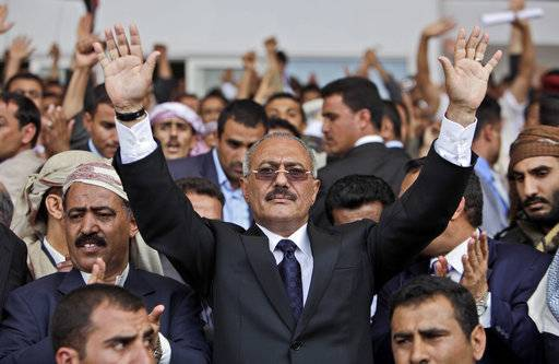 "FILE - In this April 15, 2011, file photo then Yemeni President Ali Abdullah Saleh waves to supporters in Sanaa, Yemen. Saleh, Yemen's most powerful leader, who played a central role in the country's civil war, has been killed, according to several Yemeni officials and a militias' video which showed the man dressed in a dark suit, motionless, and carried in a blanket amid chants of ""God is Great.� Saleh's death was announced Monday, Dec. 4, 2017, by Yemen's Houthi rebels, who have been fighting Saleh's forces for the past week."