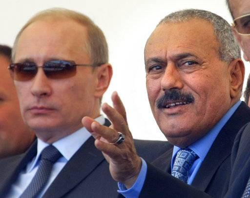 "FILE - In this June 30, 2010 file photo, then Russian Prime Minister Vladimir Putin, left, and then Yemeni President Ali Abdullah Saleh watch a military show in Zhukovsky outside Moscow. Saleh, Yemen's most powerful leader, who played a central role in the country's civil war, has been killed, according to several Yemeni officials and a militias' video which showed the man dressed in a dark suit, motionless, and carried in a blanket amid chants of ""God is Great.� Saleh's death was announced Monday, Dec. 4, 2017, by Yemen's Houthi rebels, who have been fighting Saleh's forces for the past week."