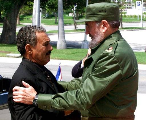 FILE - In this Sept. 12, 2000 file photo, then Cuban President Fidel Castro, right, hugs Ali Abdullah Saleh then President of Yemen, during an official welcome ceremony in Havana, Cuba. Saleh was killed by Shiite rebels, Monday, Dec. 4, 2017, as their forces battled for control of the capital, Sanaa, officials said. The collapse of their alliance throws Yemen's nearly 3-year-old civil war into unpredictable new chaos.