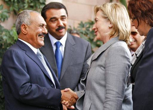 FILE - In this Jan. 11, 2011, file photo, then Yemeni President Ali Abdullah Saleh, left, shakes hands with then U.S. Secretary of State Hillary Rodham Clinton, at the Presidential Palace in Sanaa, Yemen. Saleh was killed by Shiite rebels, Monday, Dec. 4, 2017, as their forces battled for control of the capital, Sanaa, officials said. The collapse of their alliance throws Yemen's nearly 3-year-old civil war into unpredictable new chaos.