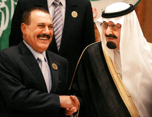 FILE - In this March 27, 2007 file photo, then Saudi King Abdullah bin Abd al-Aziz, right, shakes hands with then Yemeni President Ali Abdullah Saleh before the Arab summit in Riyadh, Saudi Arabia. Saleh, was killed Monday, Dec. 4, 2017, according to multiple Yemeni officials, as his loyalists and Shiite rebels battled for control of the capital.