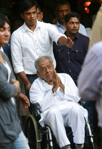 FILE- In this Jan 6, 2017 file photo, Bollywood actor Shashi Kapoor arrives to pay his final respects to noted Indian character actor Om Puri in Mumbai, India. Kapoor was felicitated at the event. Kapoor, a prolific Bollywood actor and producer from the 1970s and '80s, died Monday, Dec. 4, 2017 after a long illness. He was 79.