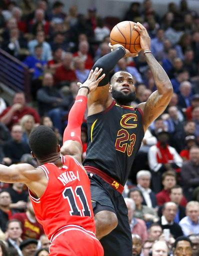 Cleveland Cavaliers' LeBron James, right, shoots over Chicago Bulls' David Nwaba during the first half of an NBA basketball game Monday, Dec. 4, 2017, in Chicago.