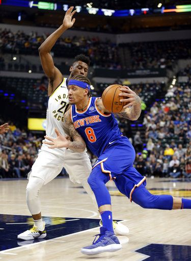 9b17c71bb58 New York Knicks forward Michael Beasley (8) drives on Indiana Pacers  forward Thaddeus Young
