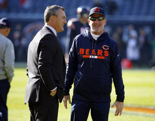 San Francisco 49ers general manager John Lynch, left, talks to Chicago Bears head coach John Fox before an NFL football game, Sunday, Dec. 3, 2017, in Chicago.