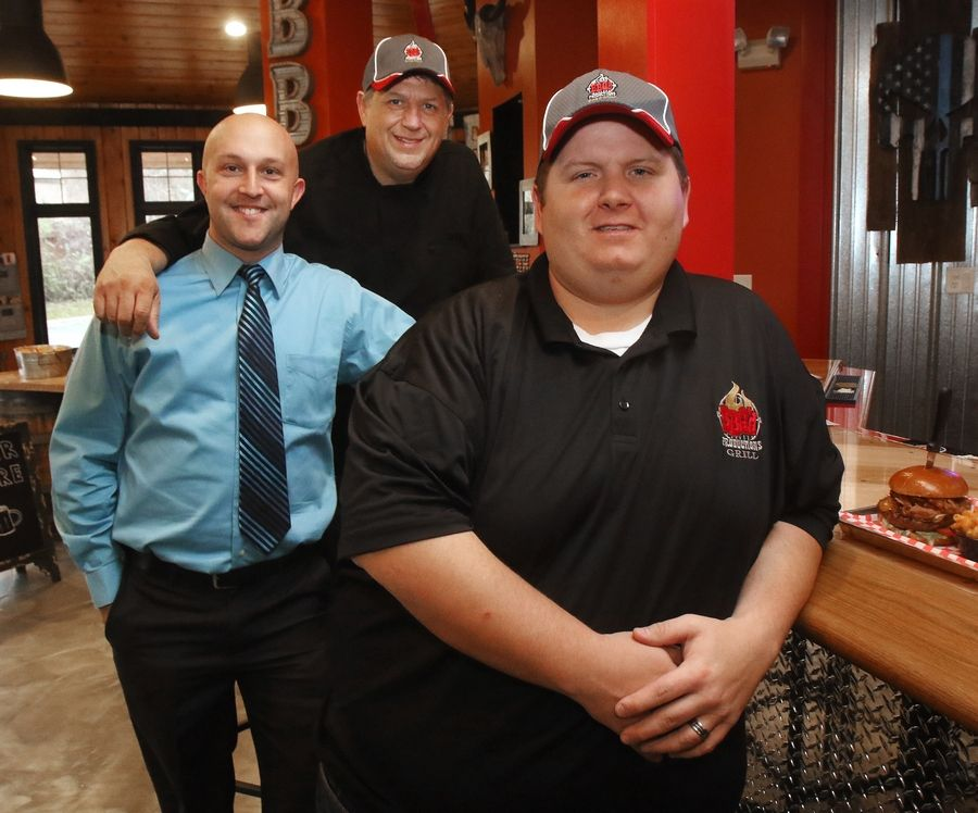 Owner Kristopher Schoenberger, right, executive chef Dean Dassler, center, and director of operations Michael Platt at BBQ'd Productions Bar & Grill in Lake Zurich.