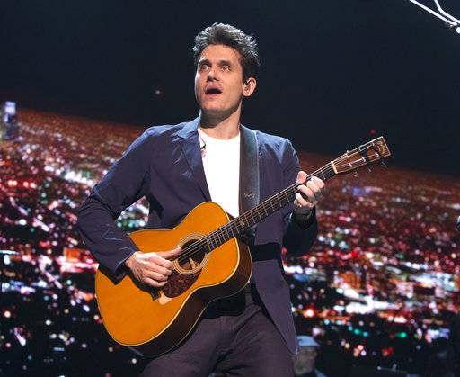 "FILe - In this April 7, 2017 file photo, John Mayer performs in concert during his ""The Search for Everything Tour"" in Philadelphia. Mayer has been hospitalized for an emergency appendectomy. The Grammy-winning musician was admitted to the hospital on Tuesday, Dec. 5, according to a rep. The singer-guitarist was due to perform later that night at a concert with the Dead & Company, but that date has now been postponed. (Photo by Owen Sweeney/Invision/AP, File)"