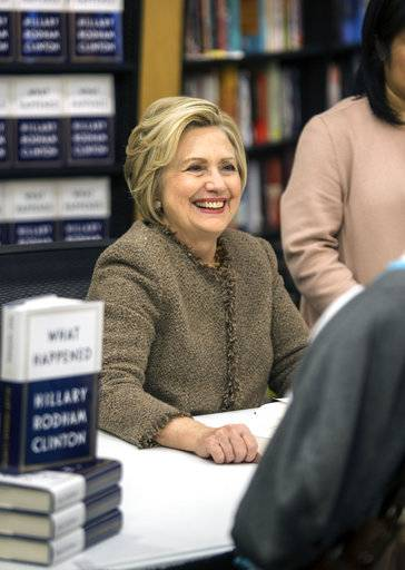Hillary Clinton smiles during her book signing at Gibson's books store in Concord, N,H., Tuesday, Dec. 5, 2017. (Geoff Forester/The Concord Monitor via AP)