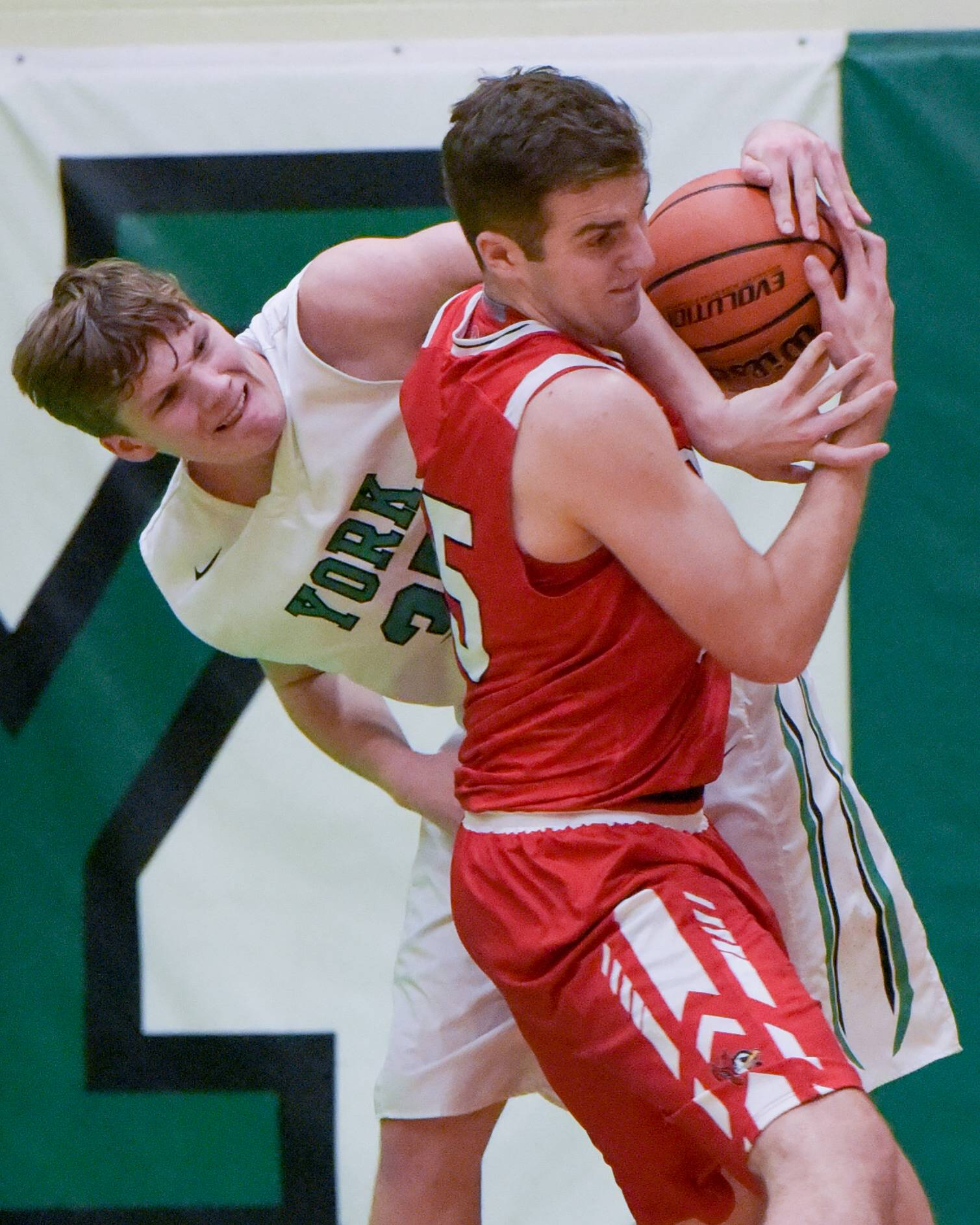 York's Sam Walsh (35) and Benet's Colin Crothers (55) struggle for control of the ball during a boys varsity basketball game on Dec. 5, 2017 in Elmhurst.