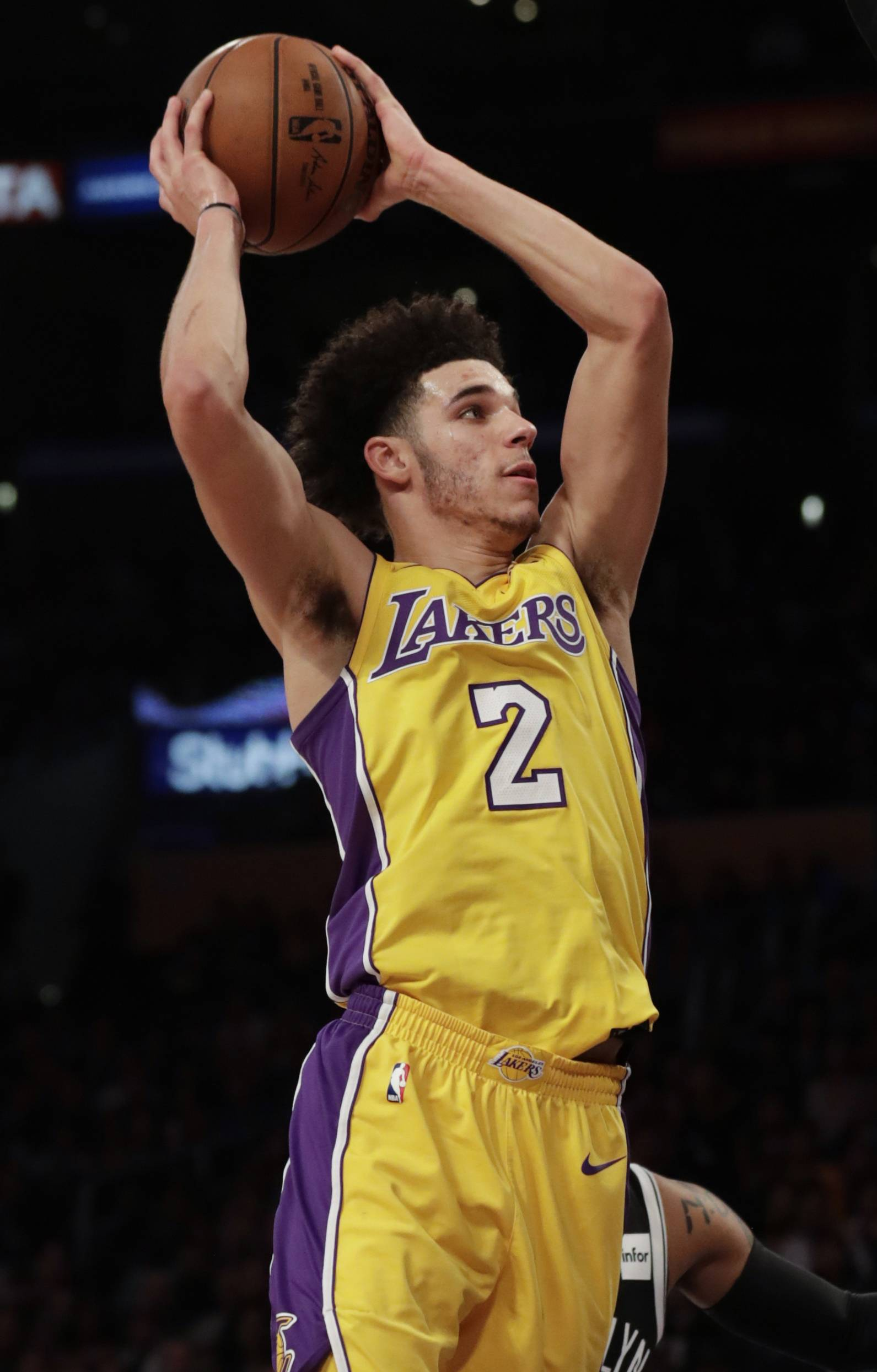 Los Angeles Lakers guard Lonzo Ball goes to the basket during the first half of an NBA basketball game against the Brooklyn Nets, Friday, Nov. 3, 2017, in Los Angeles.