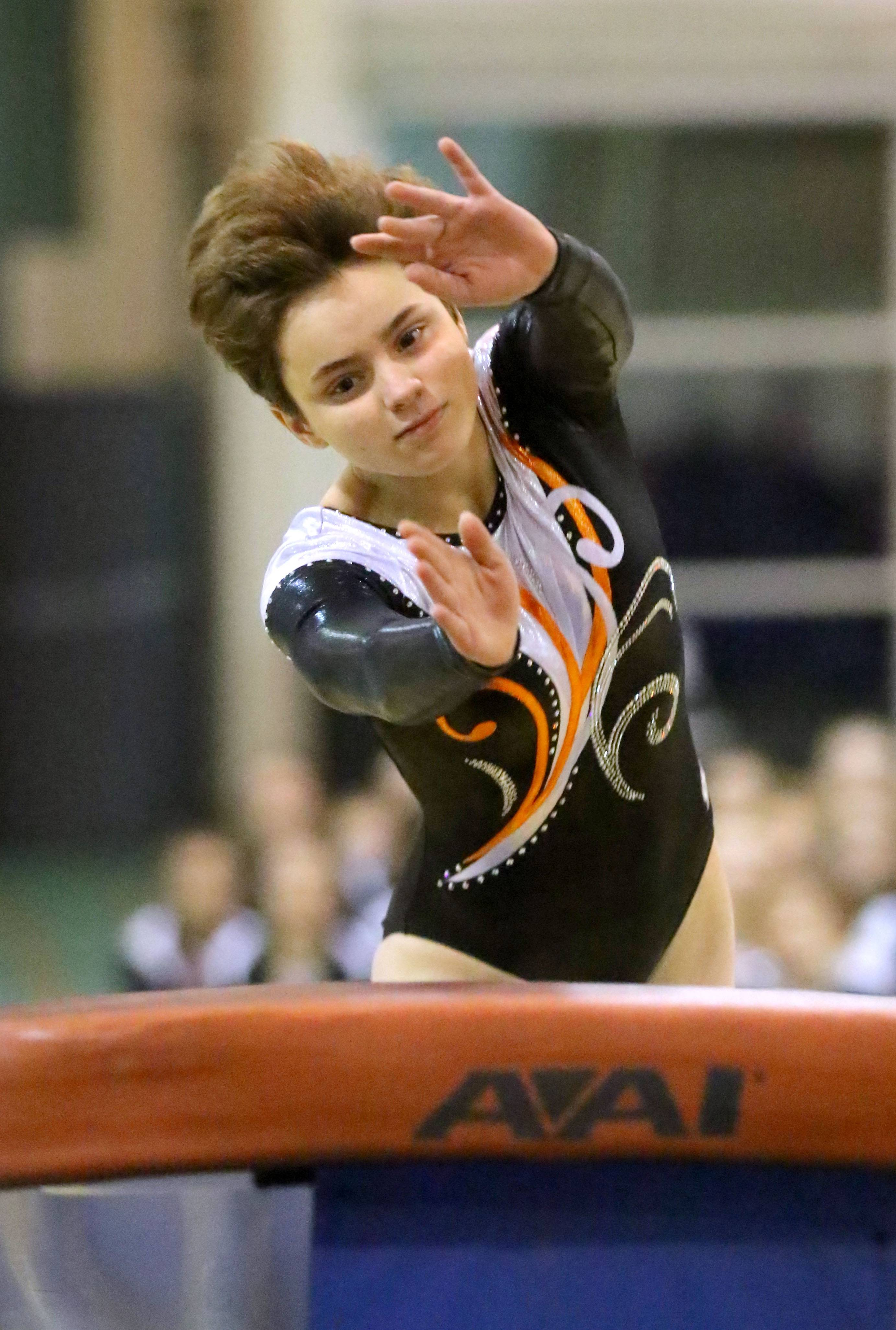 Libertyville's Liv Bertaud competes on the vault during girls gymnastics action Wednesday at Stevenson High School in Lincolnshire.