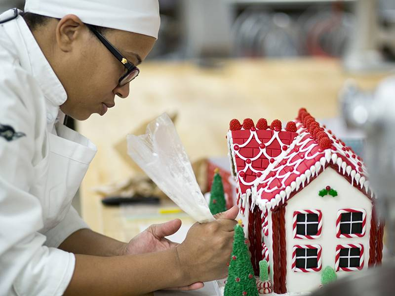 Culinary arts students at College of DuPage create gingerbread houses that will be auctioned off to raise funds for Helping Hand Center.