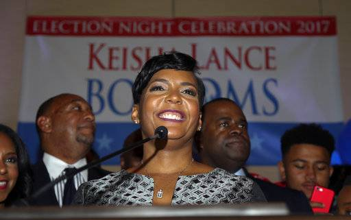 ADDS ATLANTA'S TWO-PERSON MAYORAL RUNOFF ELECTION IS TOO CLOSE TO CALL. Atlanta mayoral candidate Keisha Lance Bottoms declares victory during an election-night watch party Wednesday, Dec. 6, 2017, in Atlanta. Atlanta's two-person mayoral runoff election is too close to call. (AP Photo/John Bazemore)