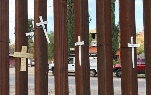 In this photo taken Monday, Dec. 4, 2017, in Nogales Mexico, crosses with the names of migrants who have died on the northbound journey to the United States. The federal government on Tuesday, Dec. 5, 2017, issued its most complete statistical snapshot of immigration enforcement under President Donald Trump, saying Border Patrol arrests plunged to a 45-year low while arrests by deportation officers soared. (AP Photo/Anita Snow)