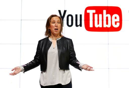 FILE - In this Tuesday, Feb. 28, 2017, file photo, YouTube CEO Susan Wojcicki speaks during the introduction of YouTube TV at YouTube Space LA in Los Angeles. In a Monday, Dec. 4, 2017, blog post, Wojcicki said that more than 10,000 workers will be helping curb videos that violate YouTube's policies from the platform. (AP Photo/Reed Saxon, File)