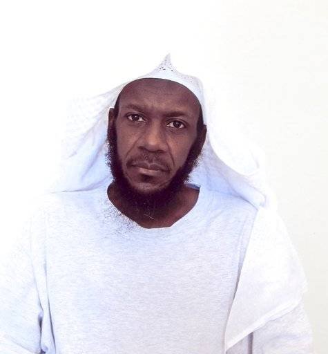 This undated photo taken by the International Red Cross and released by lawyer Walter Ruiz, shows his client Mustafa al Hawsawi posing for a portrait while he's a detainee at the Guantanamo U.S. Naval Base in Guantanamo, Cuba. On Tuesday, Dec. 5, 2017, an FBI agent has started describing the case against Mustafa al Hawsawi, a Saudi citizen accused in the Sept. 11 attack, for the first time since he was arraigned on capital charges at the Guantanamo Bay detention center more than six years ago. (Mustafa al-Hawsawi via AP)