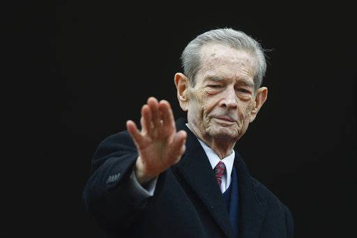 FILE - In this Wednesday, Nov. 19, 2014 file picture, Romania's former King Michael waves to supporters during an appearance at the Elisabeta Palace in Bucharest, Romania.  Romania's royal house says former King Michael, who ruled Romania during WWII, has died,  Tuesday, Dec. 5, 2017, in Switzerland aged 96.
