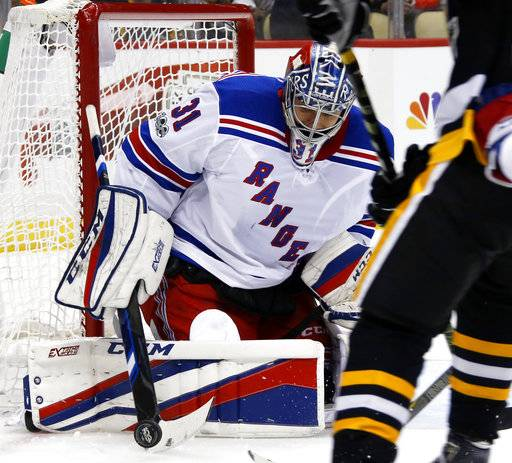 New York Rangers goalie Ondrej Pavelec (31) stops a shot by the Pittsburgh Penguins during the second period of an NHL hockey game in Pittsburgh, Tuesday, Dec. 5, 2017. (AP Photo/Gene J. Puskar)