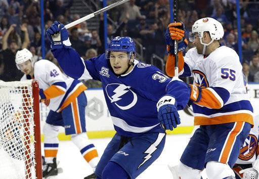 Tampa Bay Lightning center Yanni Gourde (37) celebrates after scoring against the New York Islanders during the second period of an NHL hockey game Tuesday, Dec. 5, 2017, in Tampa, Fla. Defending for the Islanders is Johnny Boychuk (55). (AP Photo/Chris O'Meara)