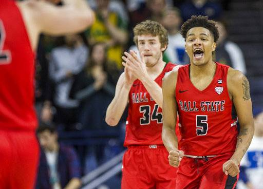 Ball State's Ishmael El-Amin (5) and Sean Sellers (34) celebrate during the second half of an NCAA college basketball game against Notre Dame Tuesday, Dec. 5, 2017, in South Bend, Ind. Ball State beat Notre Dame 80-77. (AP Photo/Robert Franklin)