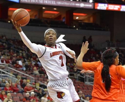 Louisville forward Myisha Hines-Allen (2) goes in for a layup around the defense of Tennessee-Martin forward Janekia Mason (10) during the first half of an NCAA college basketball game, Tuesday, Dec. 5, 2017, in Louisville, Ky. (AP Photo/Timothy D. Easley)