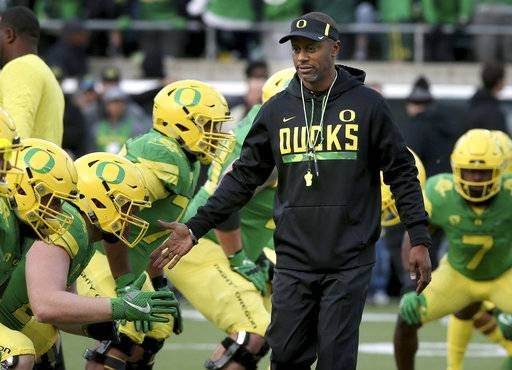 FILE - In this Nov. 18, 2017, file photo, Oregon head coach Willie Taggart, center, greets his players during warmups before an NCAA college football game against Arizona in Eugene, Ore. A person with direct knowledge of the situation says Willie Taggart has agreed to become Florida State's next football coach. The person says Taggart has called a team meeting to inform his Oregon players he is heading to Tallahassee to replace Jimbo Fisher. Florida State. The person spoke to The Associated Press Tuesday, Dec. 5, 2017, on condition of anonymity because neither school had announced the move. (AP Photo/Chris Pietsch, File)