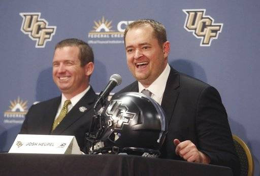 Josh Heupel, right, is introduced as the new Central Florida head football coach by Danny White, UCF Athletic director in Orlando, Fla., Tuesday, Dec. 5, 2017. Heupel has been the offensive coordinator at Missouri the past two seasons. He replaces Scott Frost, who accepted the Nebraska coaching job after leading UCF to a 12-0 record and the American Athletic Conference title. (Red Huber/Orlando Sentinel via AP)