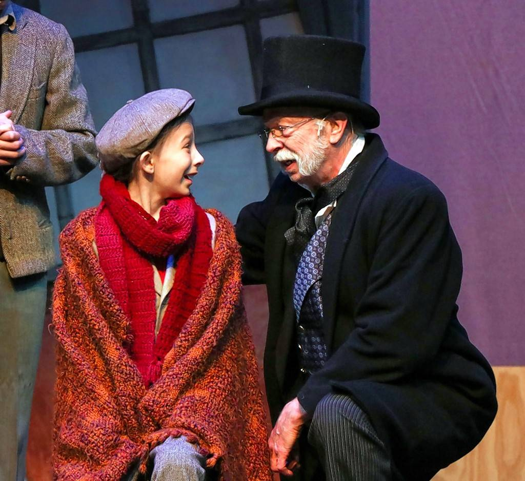 "Jerry M. Miller plays Ebenezer Scrooge opposite Kaia Mavradas' Tiny Tim in ""A Christmas Carol"" at the Metropolis Performing Arts Centre. Mavradas shares the role with Jahnavi Karandikar and Kayden Koshelev."