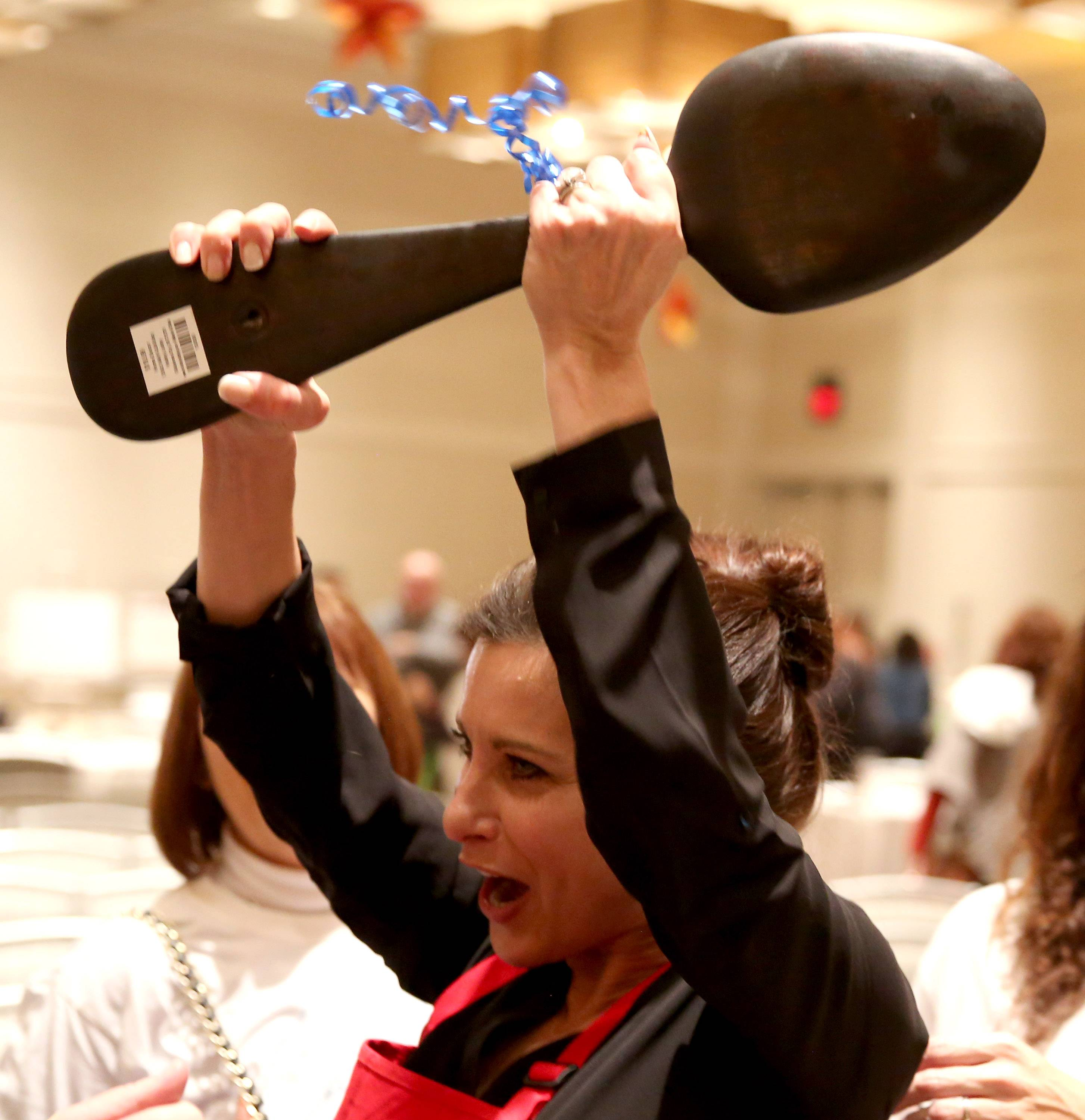 Elizabeth Schuttler of Inverness wins the 2017 Daily Herald Cook of the Week Challenge following a live cooking competition at the Westin Chicago Northwest in Itasca. Schuttler parades through well wishers with her wooden spoon trophy.