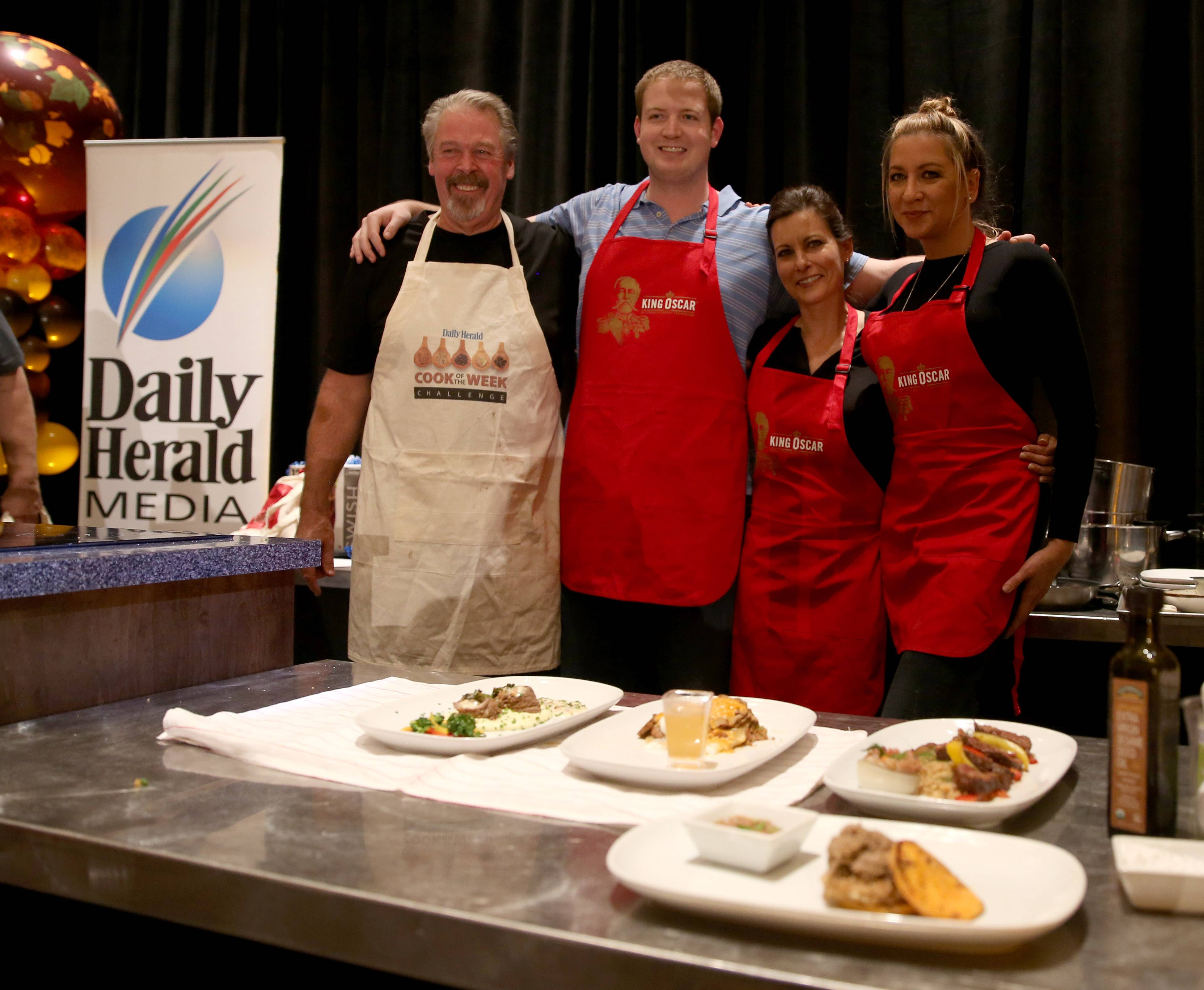 The final four contestants pose with their plated dishes. From left, Mark Clemens of Elgin, Ben Blake of Winfield, Schuttler and Darla Pitts of Chicago had one hour to prepare dishes using five secret ingredients.