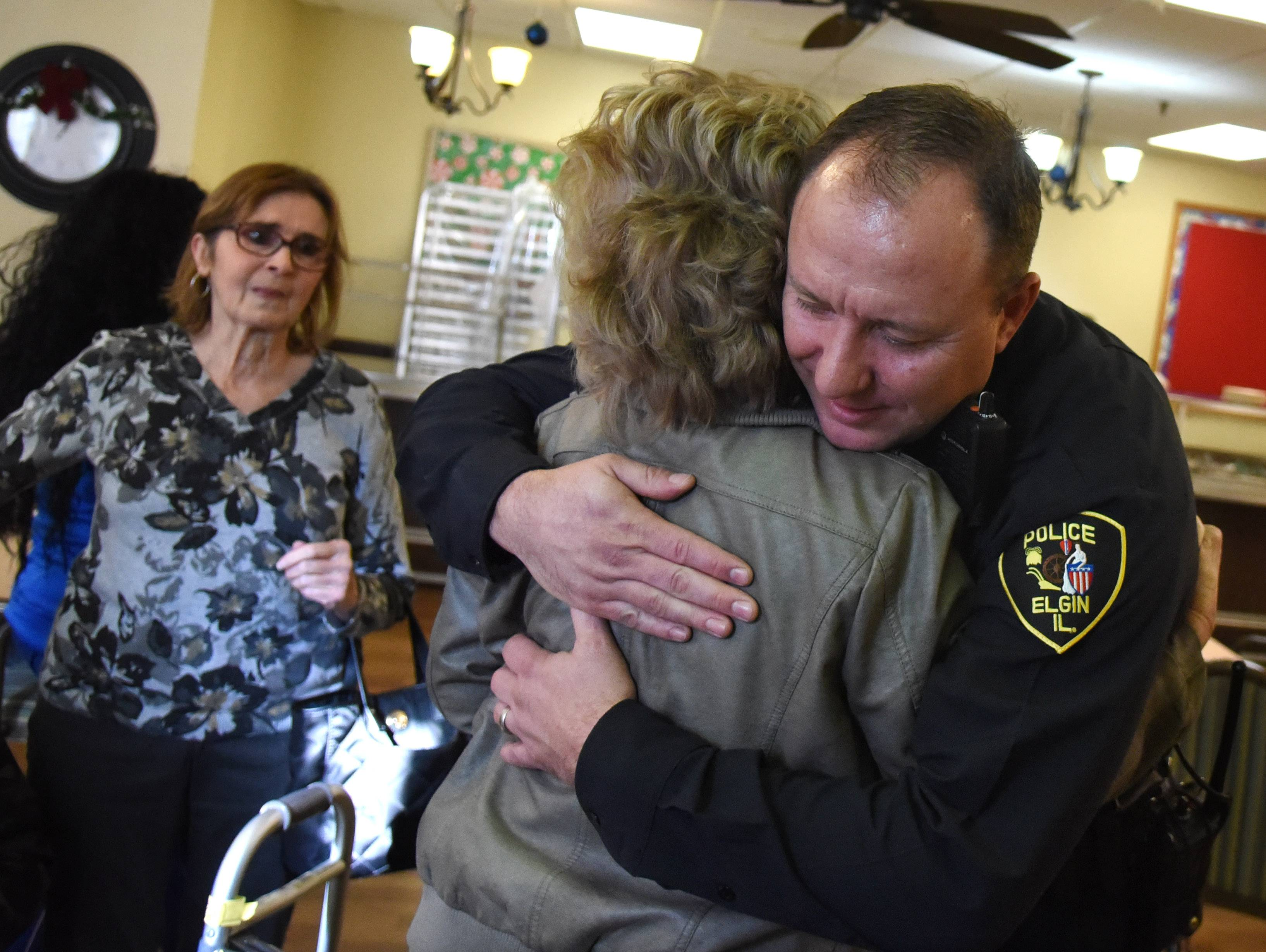 "Elgin police officer Jason Lentz hugs Pat Marshall of Algonquin at the River View Rehab Center in Elgin. Lentz saved her brother James ""Jim"" May's life Thanksgiving Day."