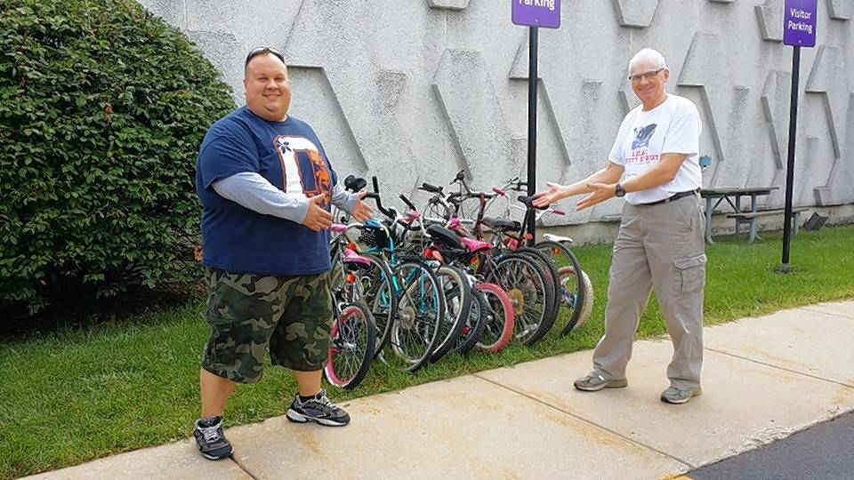 Dennis McNicholas, right, with Jason Nelson, shows some of the used bikes collected for children in the south African Kingdom of Lesotho.