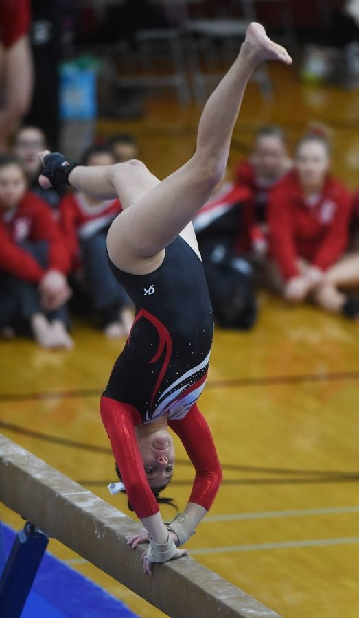 Palatine's Abby Amato competes on the balance beam during Wednesday's home meet against Barrington.