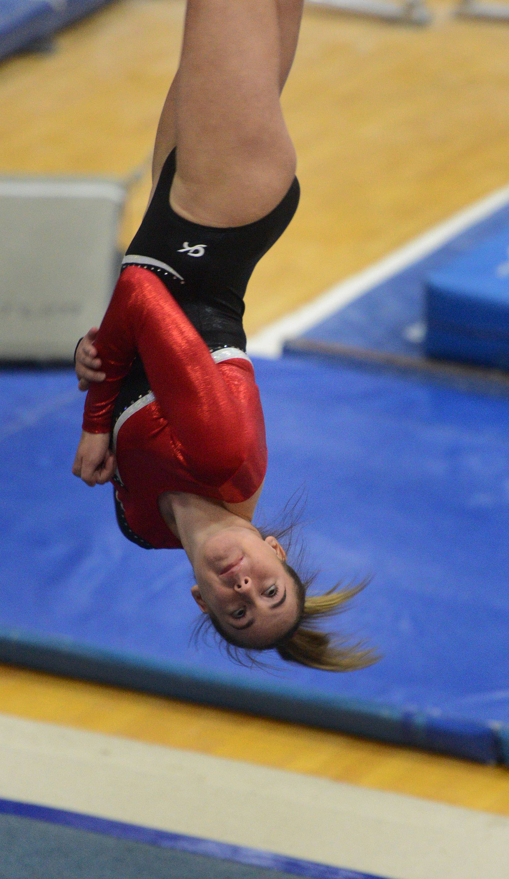 Barrington's Brooke Husby competes on the floor exercise during Wednesday's meet at Palatine.