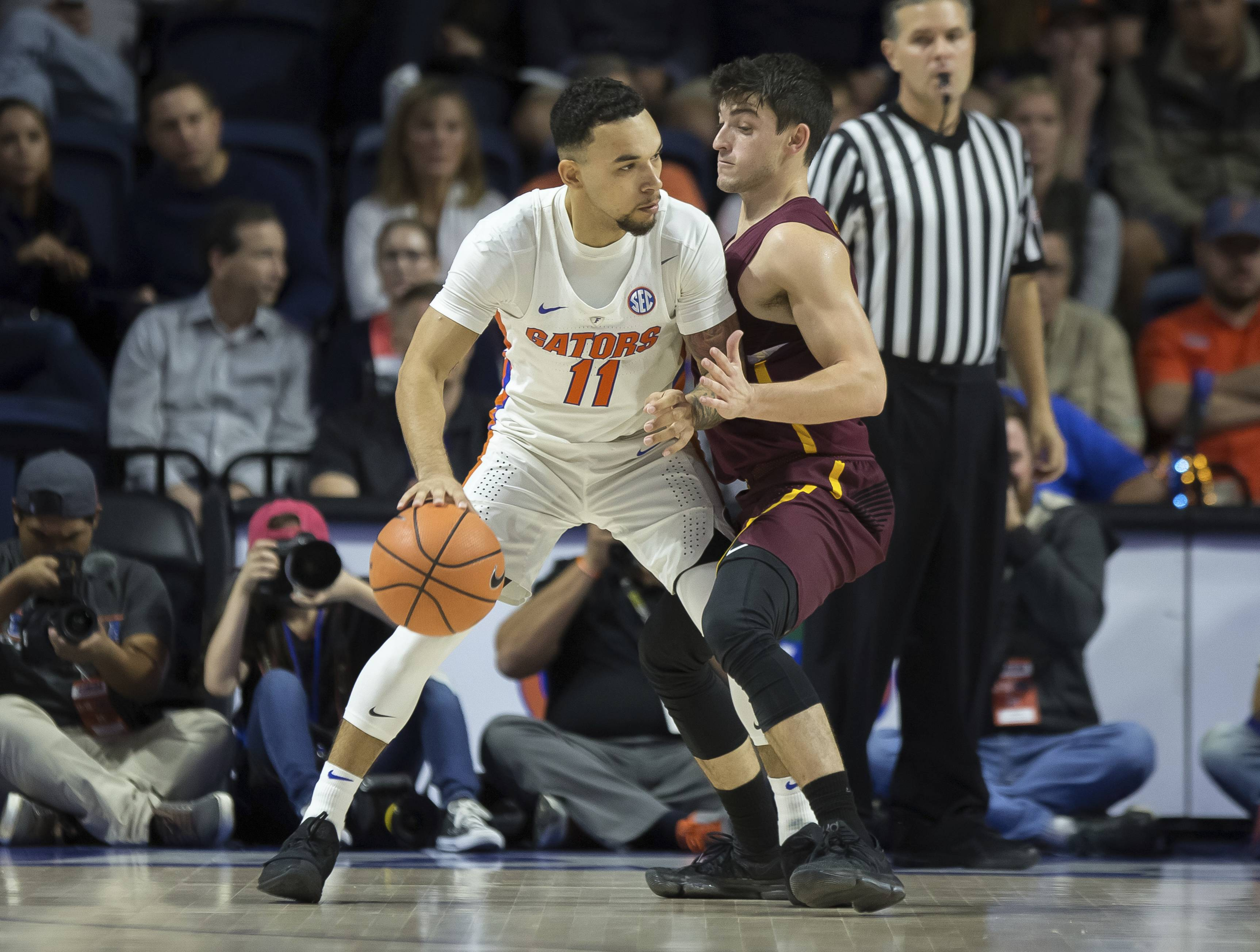 Loyola of Chicago guard Clayton Custer (13) plays tight defense against Florida guard Chris Chiozza (11) during the first half of an NCAA college basketball game in Gainesville, Fla., Wednesday, Dec. 6, 2017.