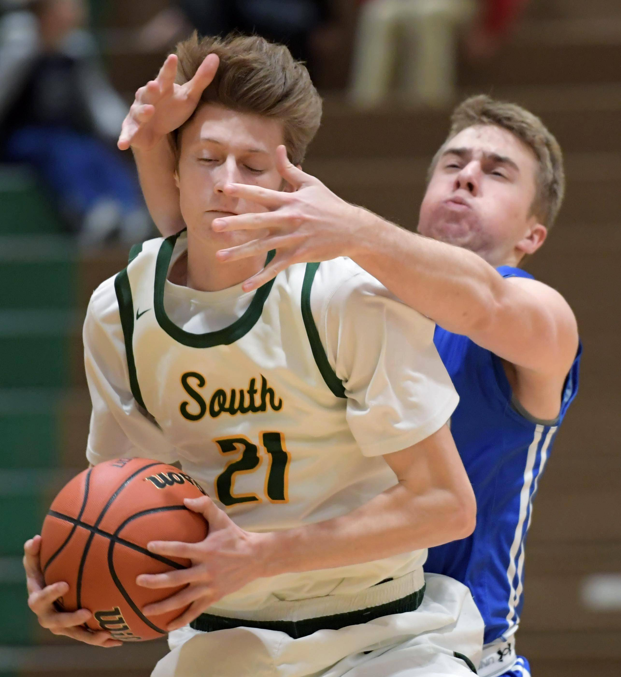 Burlington Central's Caden Scott's hands fly around the face of Crystal Lake South's Matthew Reall Wednesday in Crystal Lake.