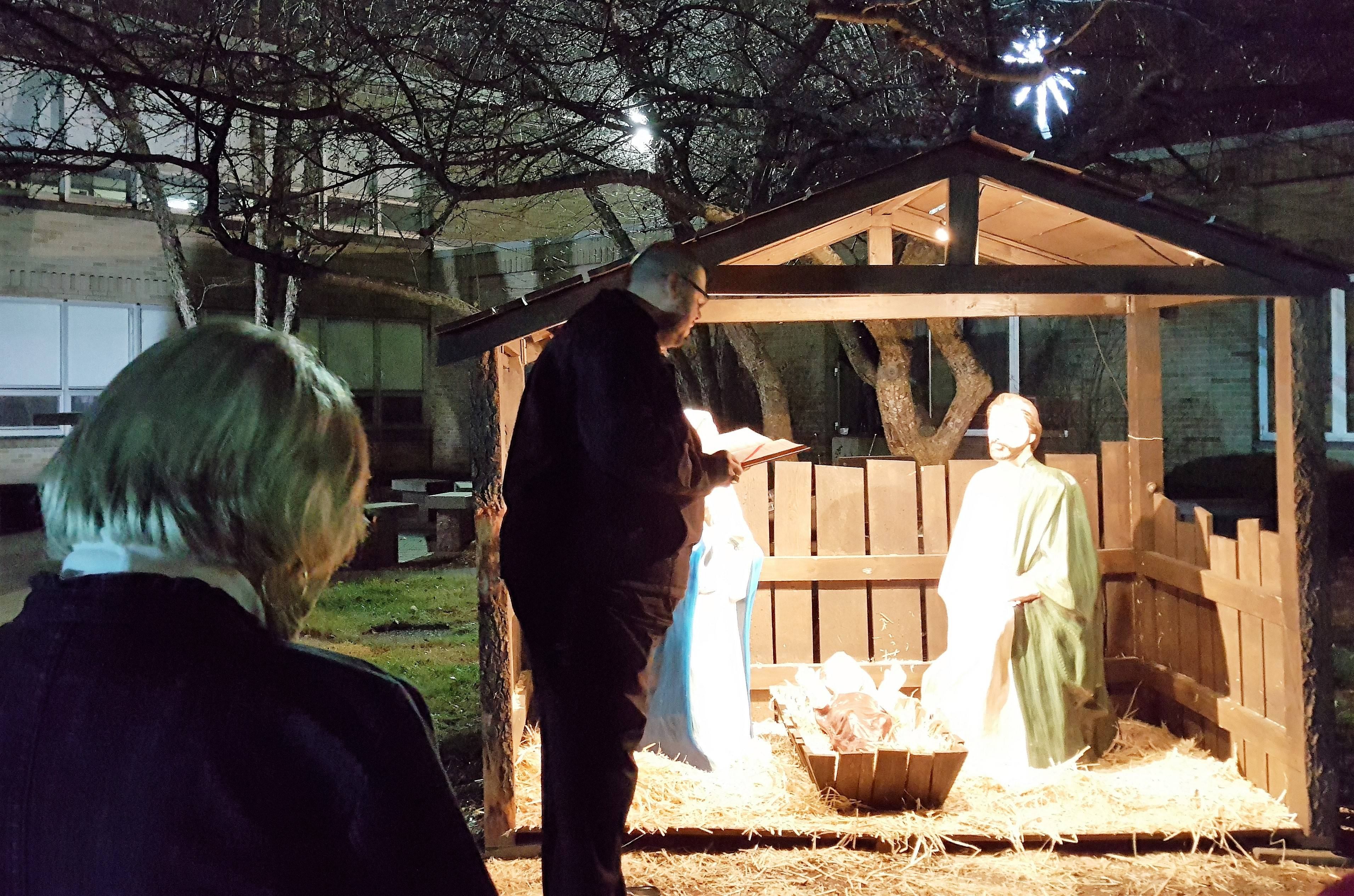 Father Matthew DeBlock, pastor of St. Catherine of Siena Church in West Dundee, blesses the Nativity scene outside the church.