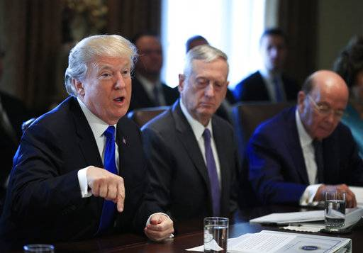 President Donald Trump with Secretary of Defense Jim Mattis, center and Secretary of Commerce Wilbur Ross, right, speaks during a cabinet meeting in the Cabinet Meeting Room of the White House in Washington, Wednesday, Dec. 6, 2017.