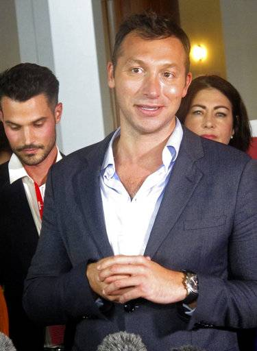 Australian former Olympic champion swimmer Ian Thorpe addresses reporters at Parliament House in Canberra, Australia, on Thursday, Dec. 7, 2017.  Australia's Parliament has voted to allow same-sex marriage across the nation, following a bitter debate settled by a much-criticized government survey of voters that strongly endorsed change. Champagne and tears of flowed in the halls of Parliament House as gay celebrities including Olympic champion swimmer Ian Thorpe and actress Magda Szubanski hugged lawmakers and ordinary folk in a party atmosphere.