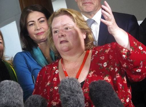 Australian actress Magda Szubanski celebrates at Parliament House in Canberra, Australia, Thursday, Dec. 7, 2017. The Parliament voted to allow same-sex marriage across the nation, following a bitter debate settled by a much-criticized government survey of voters that strongly endorsed change.