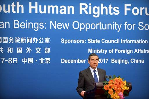 Chinese Foreign Minster Wang Yi speaks during the South-South Human Rights Forum at the Great Hall of the People in Beijing, Thursday, Dec. 7, 2017. China opened a human rights forum attended by developing countries Thursday in its energetic drive to showcase what it considers the strengths of its authoritarian political system under President Xi Jinping.