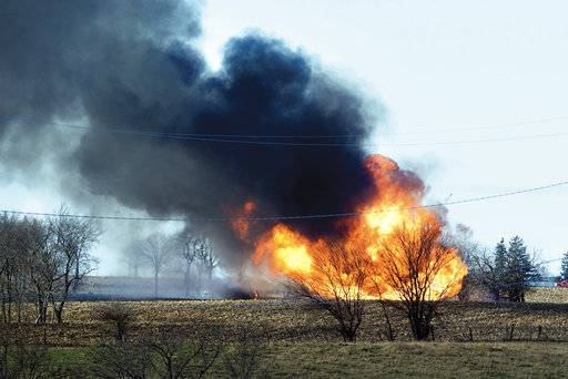 Fire rages at the scene of a natural gas pipeline explosion that sent flames and dark smoke into the air Tuesday, Dec. 5, 2017, outside of Dixon, Ill. The Lee County Sheriff's Department says the explosion happened on a farm near Nachusa. The Illinois State Fire Marshal's Office also said that it has investigators at the scene. (Alex T. Paschal /The Telegraph via AP)