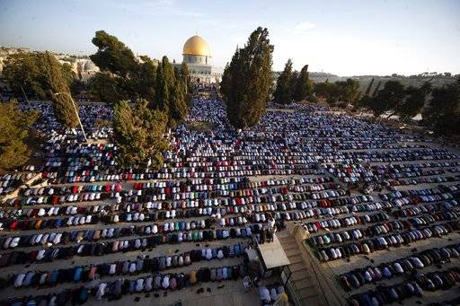 "FILE - In this Sept. 24, 2015 file photo, Palestinians pray during the Muslim holiday of Eid al-Adha, near the Dome of the Rock Mosque in the Al Aqsa Mosque compound in Jerusalem's old city. Saudi Arabia has spoken out strongly against any possible U.S. recognition of Jerusalem as Israel's capital. In a statement on the state-run Saudi Press Agency, the Foreign Ministry said Tuesday, Dec. 5, 2017,  that the kingdom affirms the rights of Palestinian people regarding Jerusalem which it said ""cannot be changed.�"